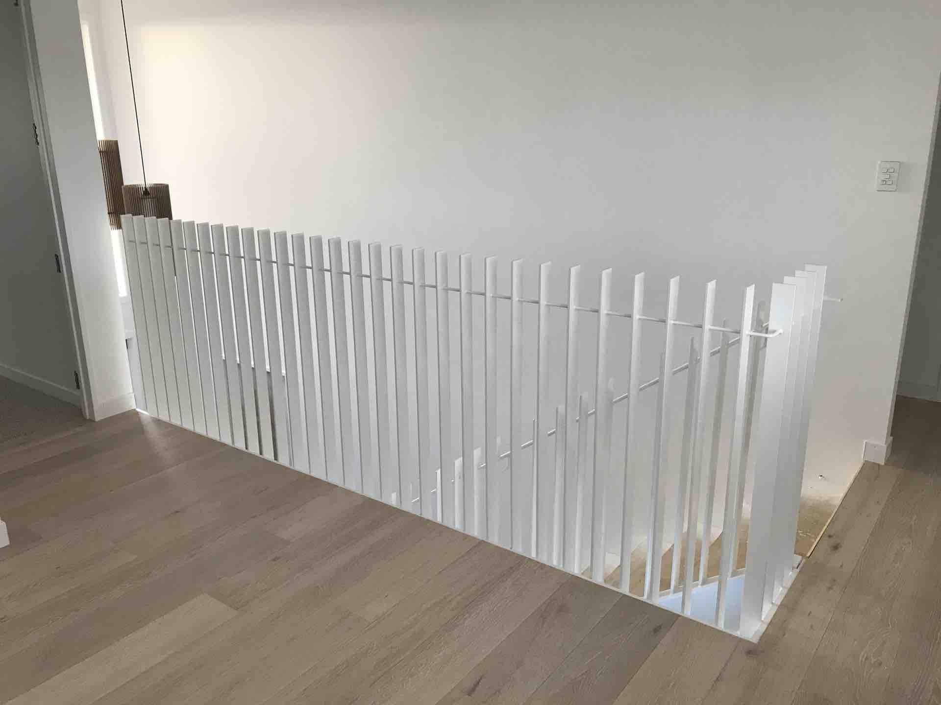 Steel balustrade powder coated in white