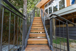Stairworks fabricated metal balustrades and handrails on this exterior staircase