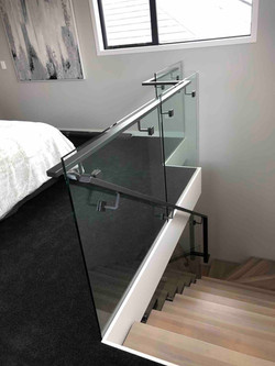 Glass balustrade creates separation on floating staircase