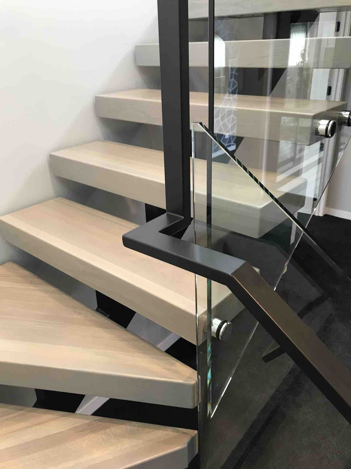 Metal handrail on floating stairs