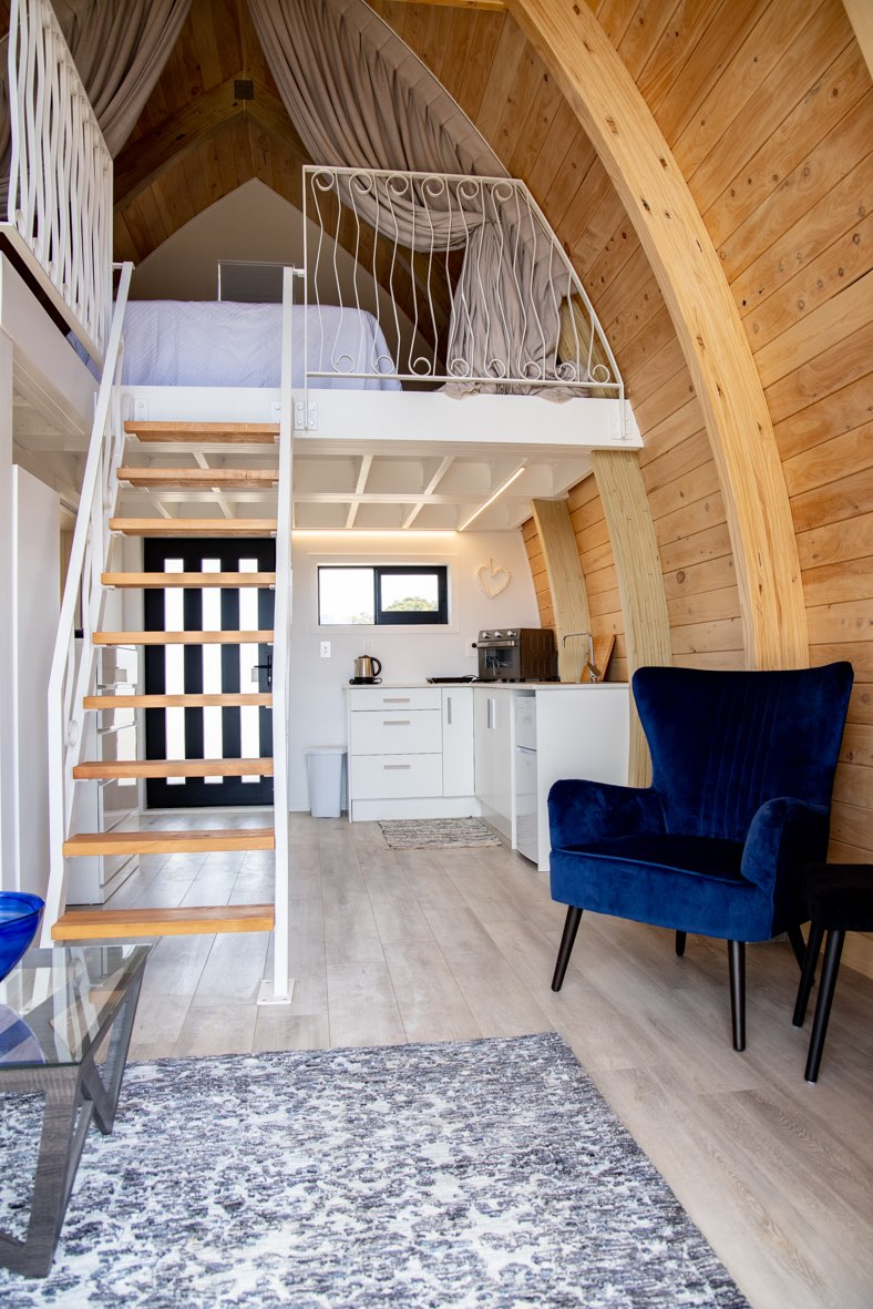 Tiny home stairs save space and allow light in Auckland, NZ