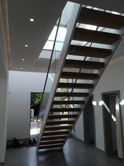 Glass balustrades built to allow light in from skylight above