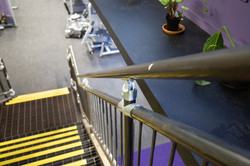 Steel handrail and landing on industrial style stairs built by Stairworks