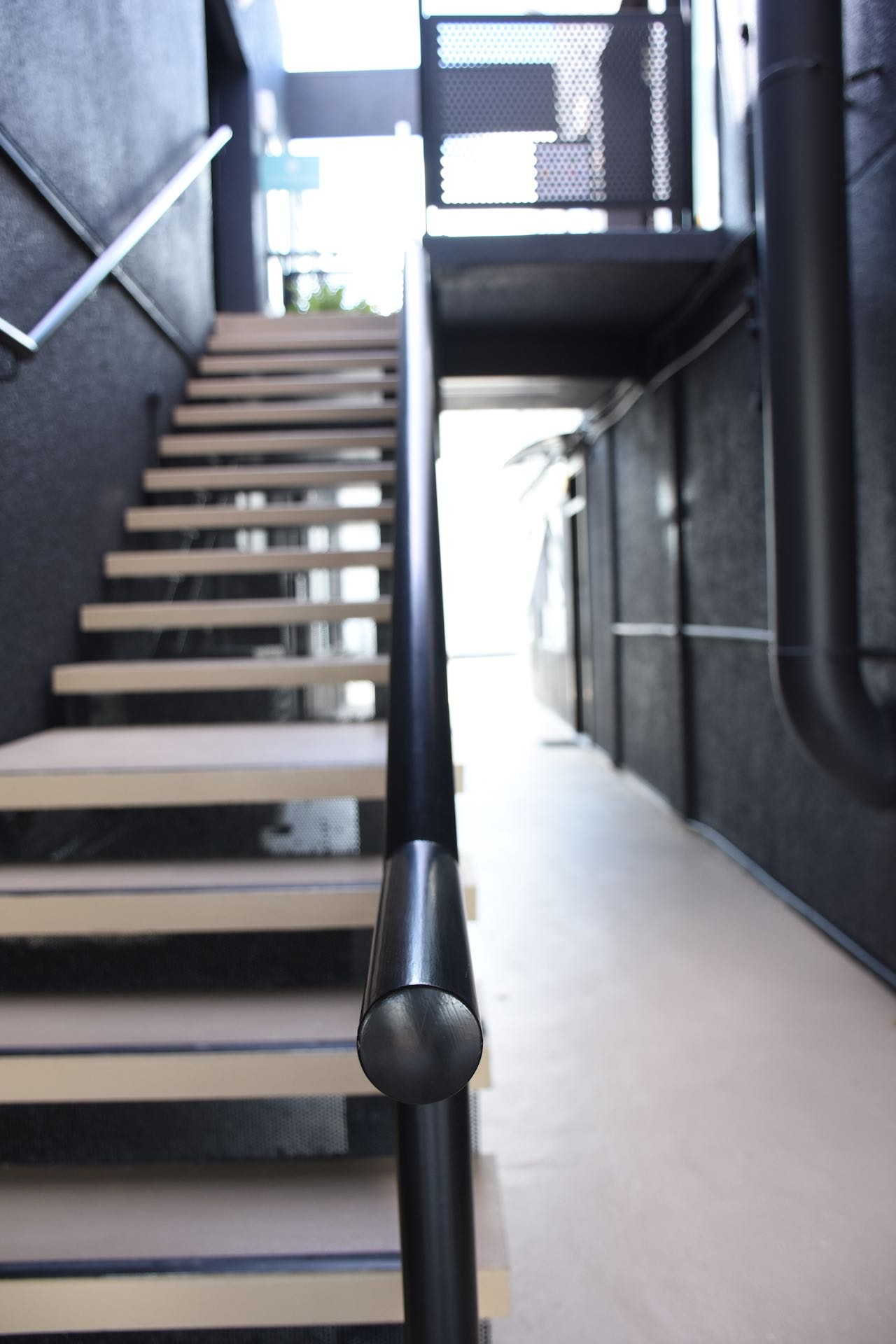 Steel handrail for stairs in Auckland commercial building.
