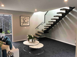 Floating staircase in show home in Auckland