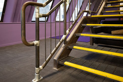 Steel handrails and balustrades on industrial style staircase by Stairworks