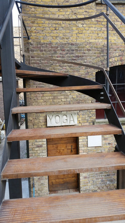 Timber treads and steel balustrades on external staircase fabricated by Stairworks