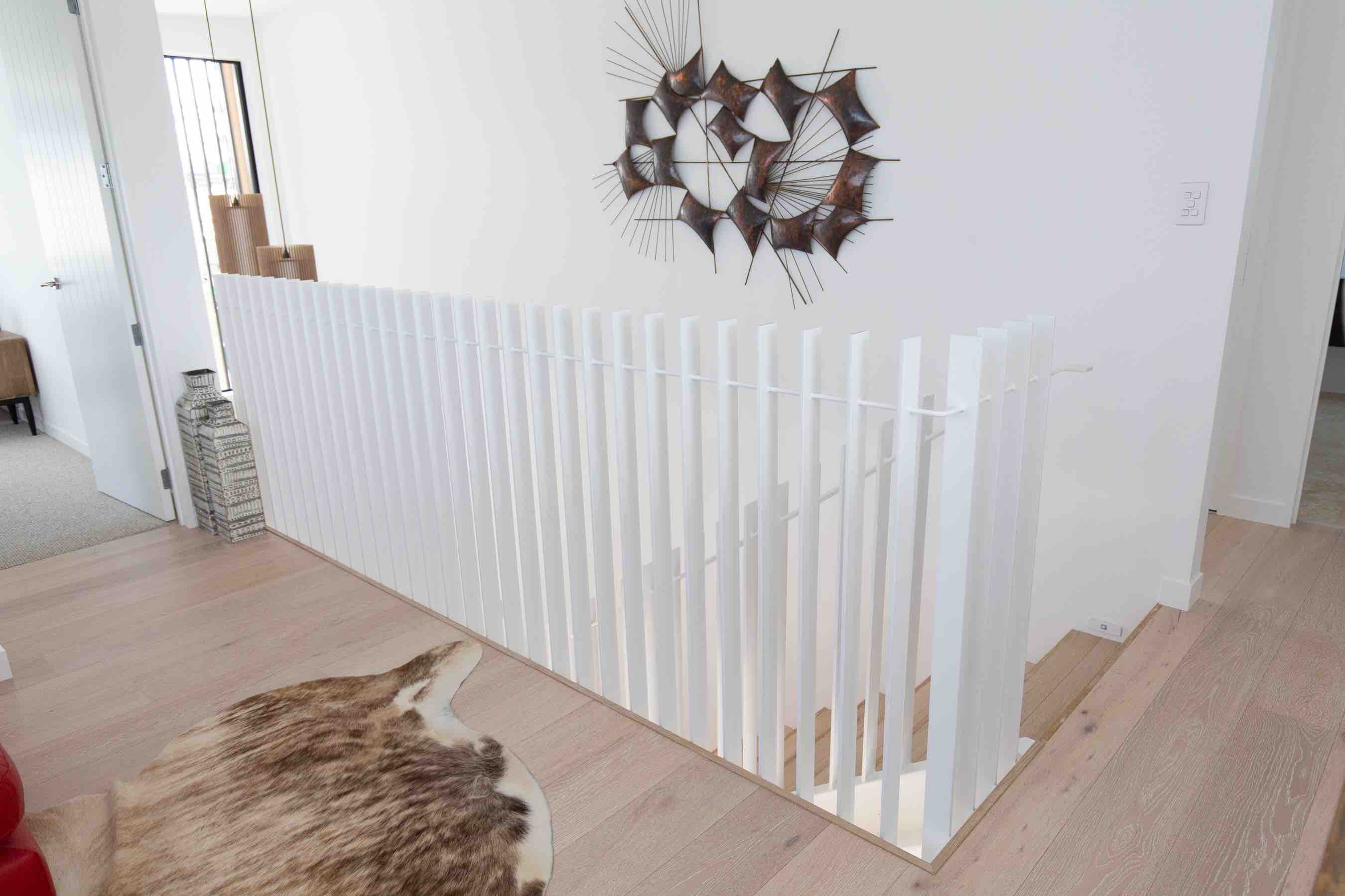 Clean metal balustrade design in this staircase renovation in Auckland, NZ