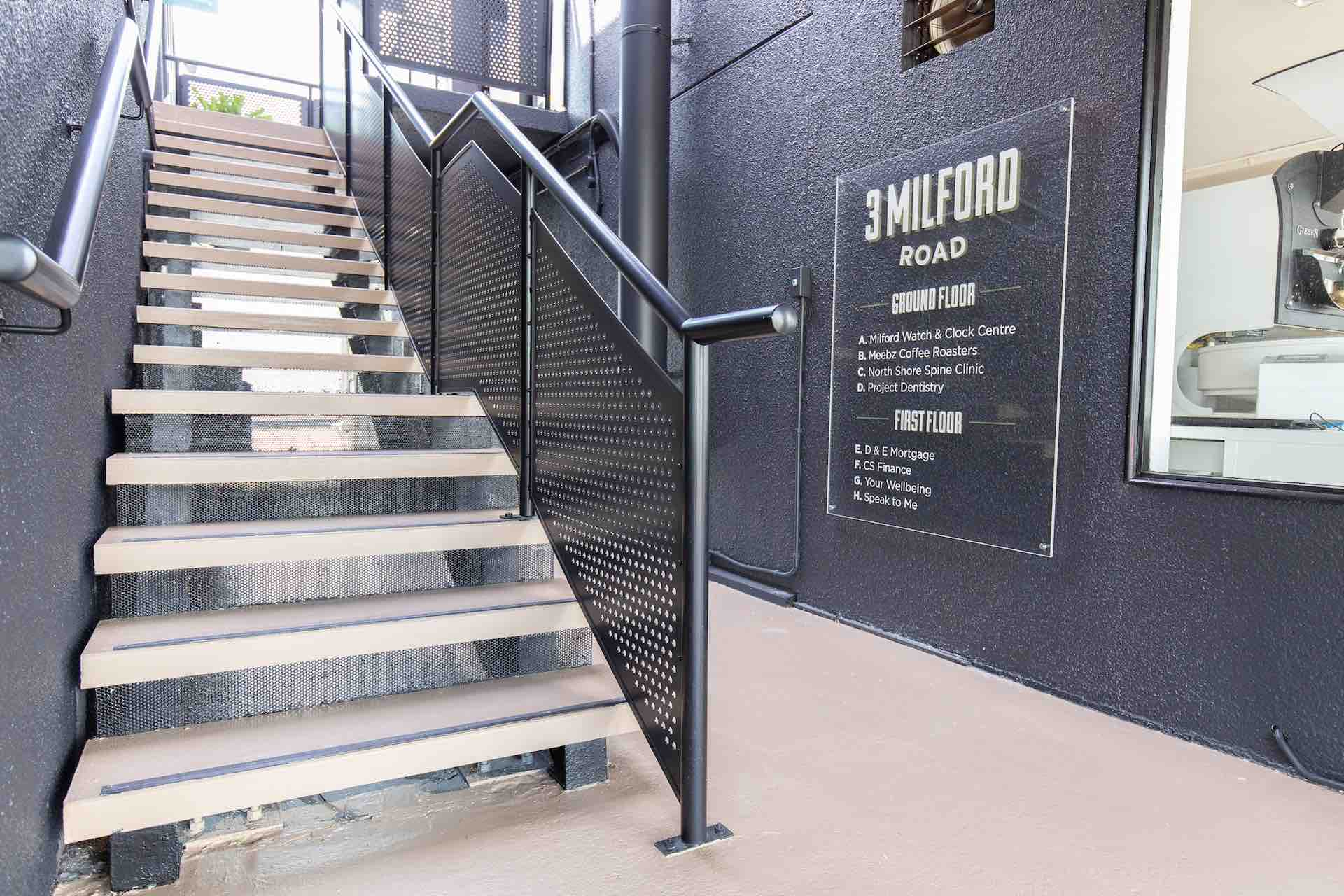 Exterior staircase with metal balustrade and handrail system in Auckland.