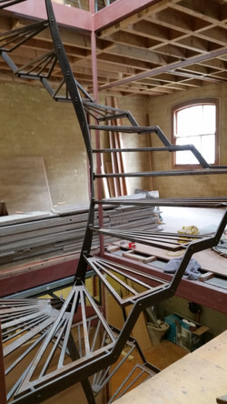 Steel treads on a spiral staircase for a commercial property in Auckland