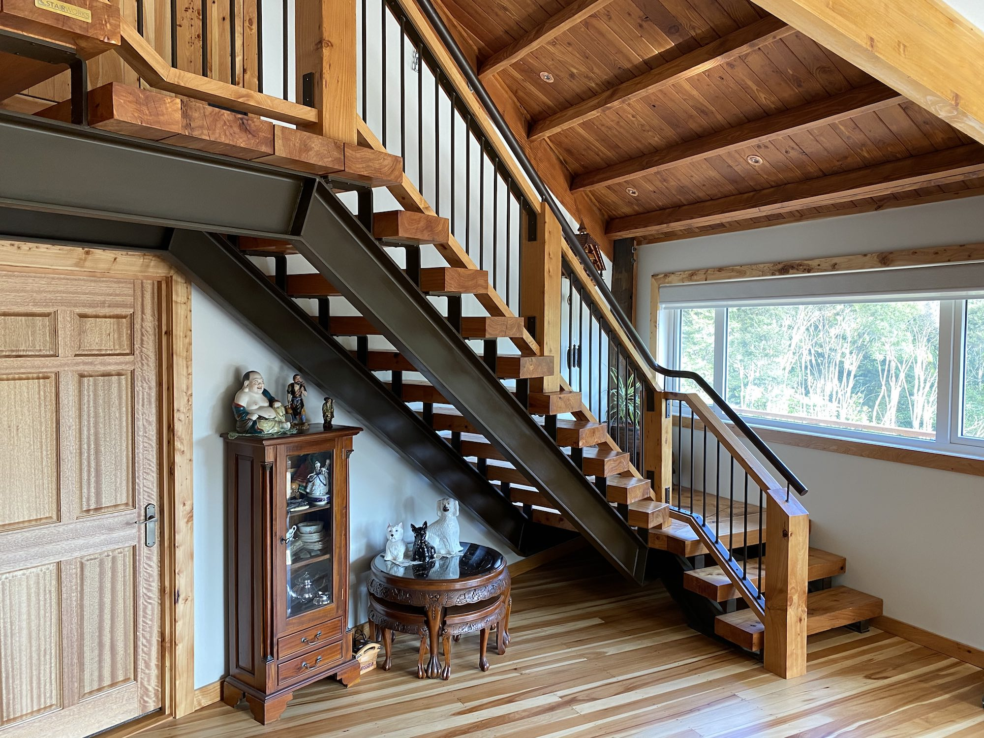 Reclaimed wood and steel were used to give this staircase in Auckland a rustic and imperfect aesthet