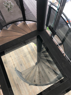 Stair design by Stairworks for architectural spiral staircase with timber and glass treads