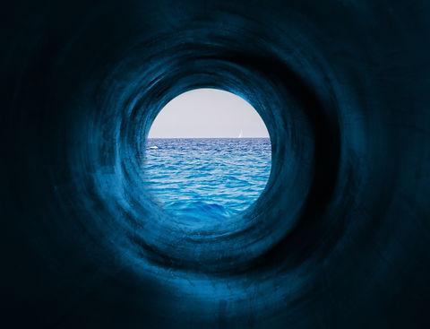 Blue tunnel to the calm sea. May symboli