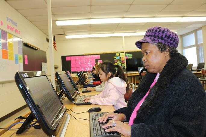 Children and adults learn side-by-side at the Plainfield Public Schools Saturday Academy Here Jenny Ixcuna, 7, and Ms. Sena Wiggins in Math Concepts and Computer Class.
