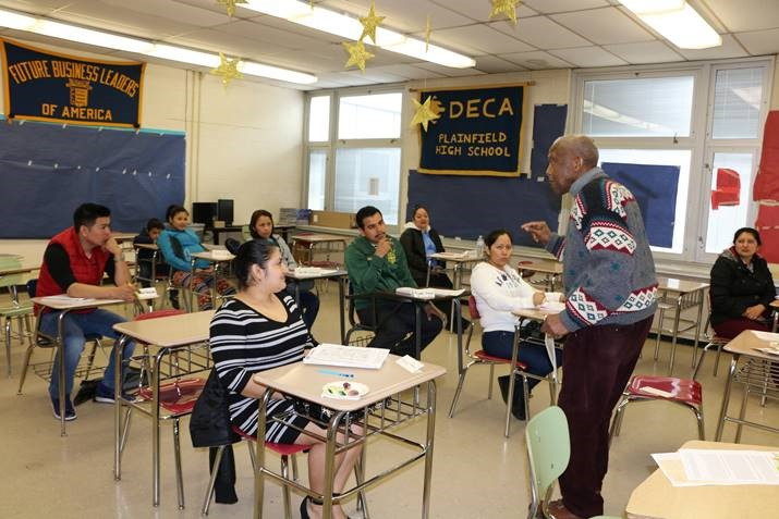 Volunteer Retired Rutgers Professor Mr. William Jones, teaching ESL Level I to students.