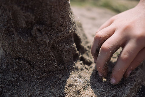 small-hand-in-the-sand.jpg