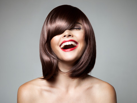Smiling Beautiful Woman With Brown Short