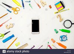 mobile-phone-in-the-desk-white-backgroun