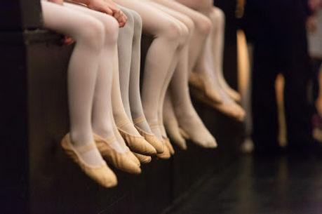 reherasal feet- edge of stage sitting.jp