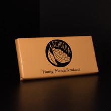 Vollmilchschokolade mit Honig und Mandelkrokant