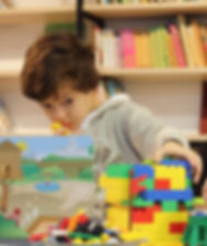 child playing with legos
