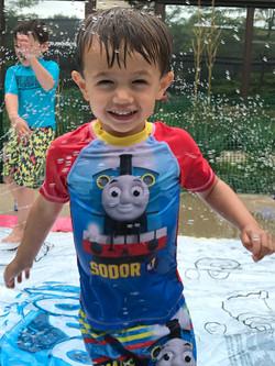 Child in sprinkler