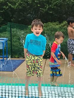 Boy in sprinkler