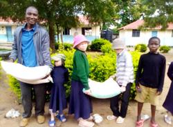 Pastor Titus brings food to school
