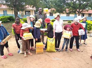 Albino kids with food purchased.jpeg