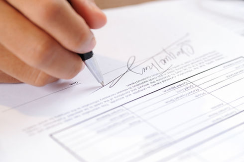 closeup-person-signing-document-with-bal