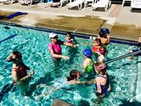Swim instructor teaching group lesson