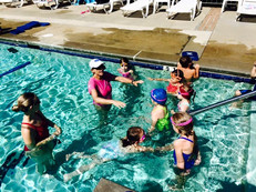 Swim instructor teaching group lesson