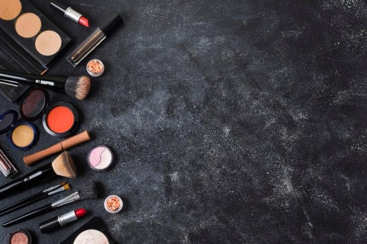 cosmetics-arranged-dusty-dark-background_23-2148181475.jpg