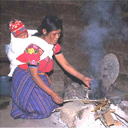Women with infants, cooking indoors.