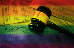 Court gavel on rainbow flag colored page