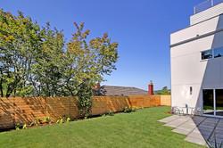 Fully-fenced yard, awaiting a garden