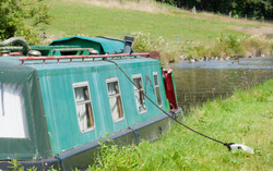 Narrowboat on canal at Strines