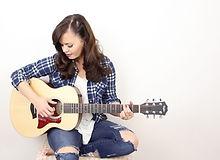 Susie Brown Taylor Guitars.jpg