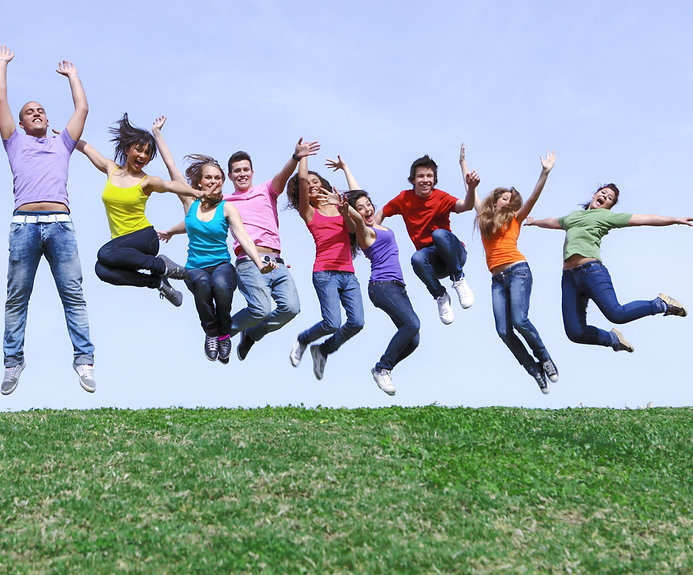Happy smiling diverse group of jumping t