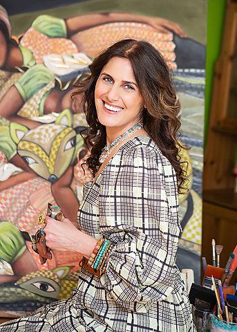 Jazmin Sasky painting in her art studio