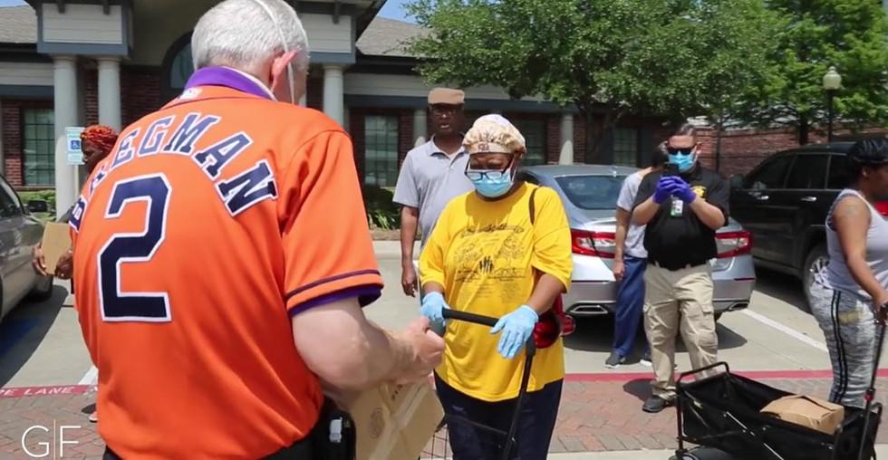 Mattress Mack distributing food to those in need.