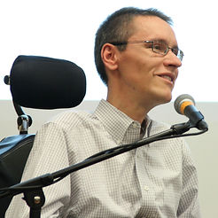 Scott Hatley (Co-Founder) Speaking into a microphone