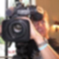 Headshot of Judd Girard holding a videocamera