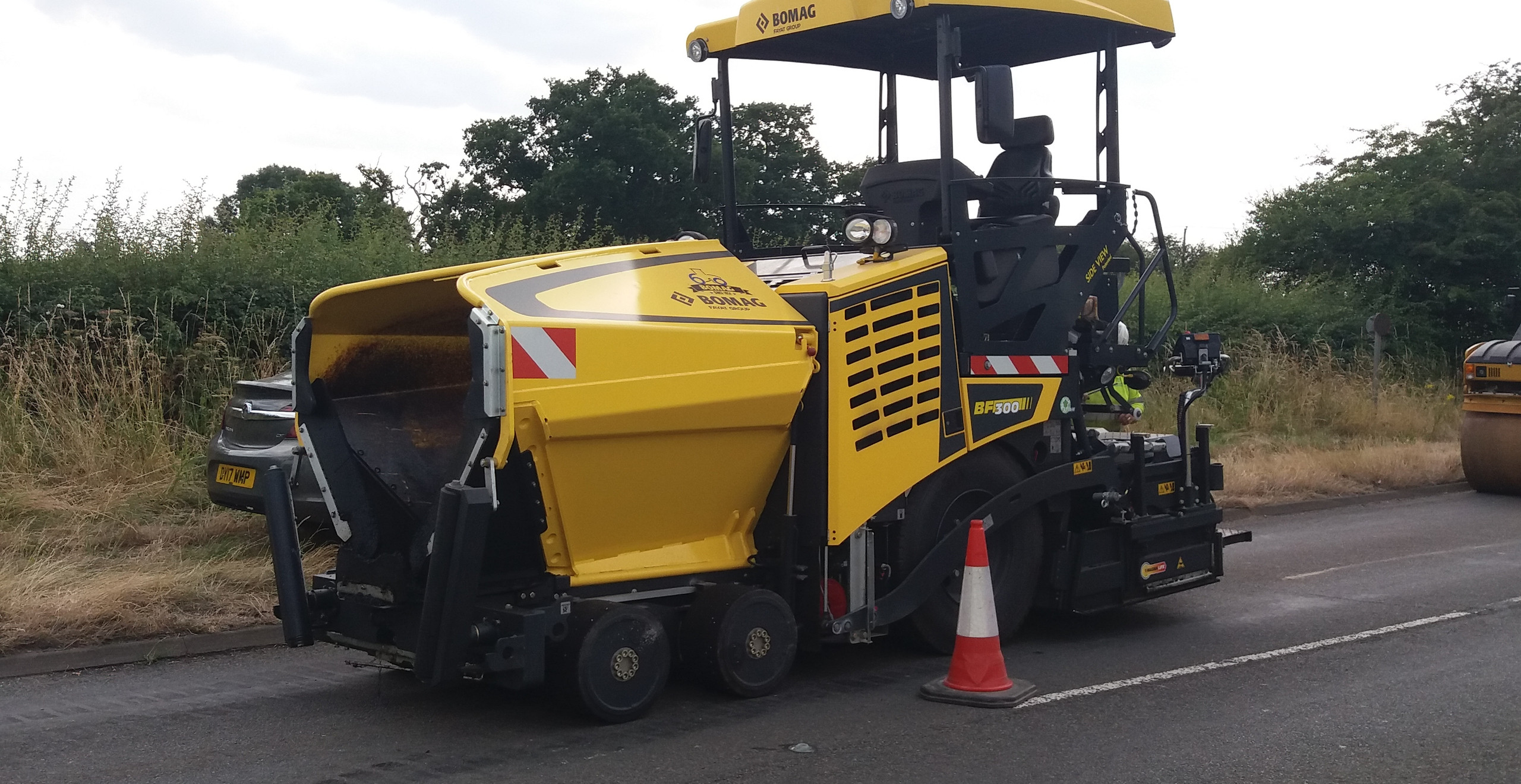 Hilton Main Construction crew working with paver in response to accident on A5 road west midlands