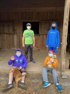 4 boys volunteering.jpg