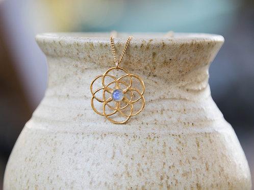 תליון ציפוי זהב זרע החיים, משובץ אבן לברדורייט