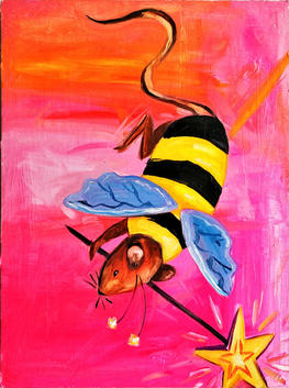 A rat wearing a bee costume