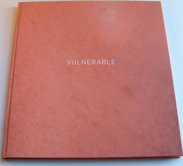 Bespoke Photographic Paper Binding with White Lettering