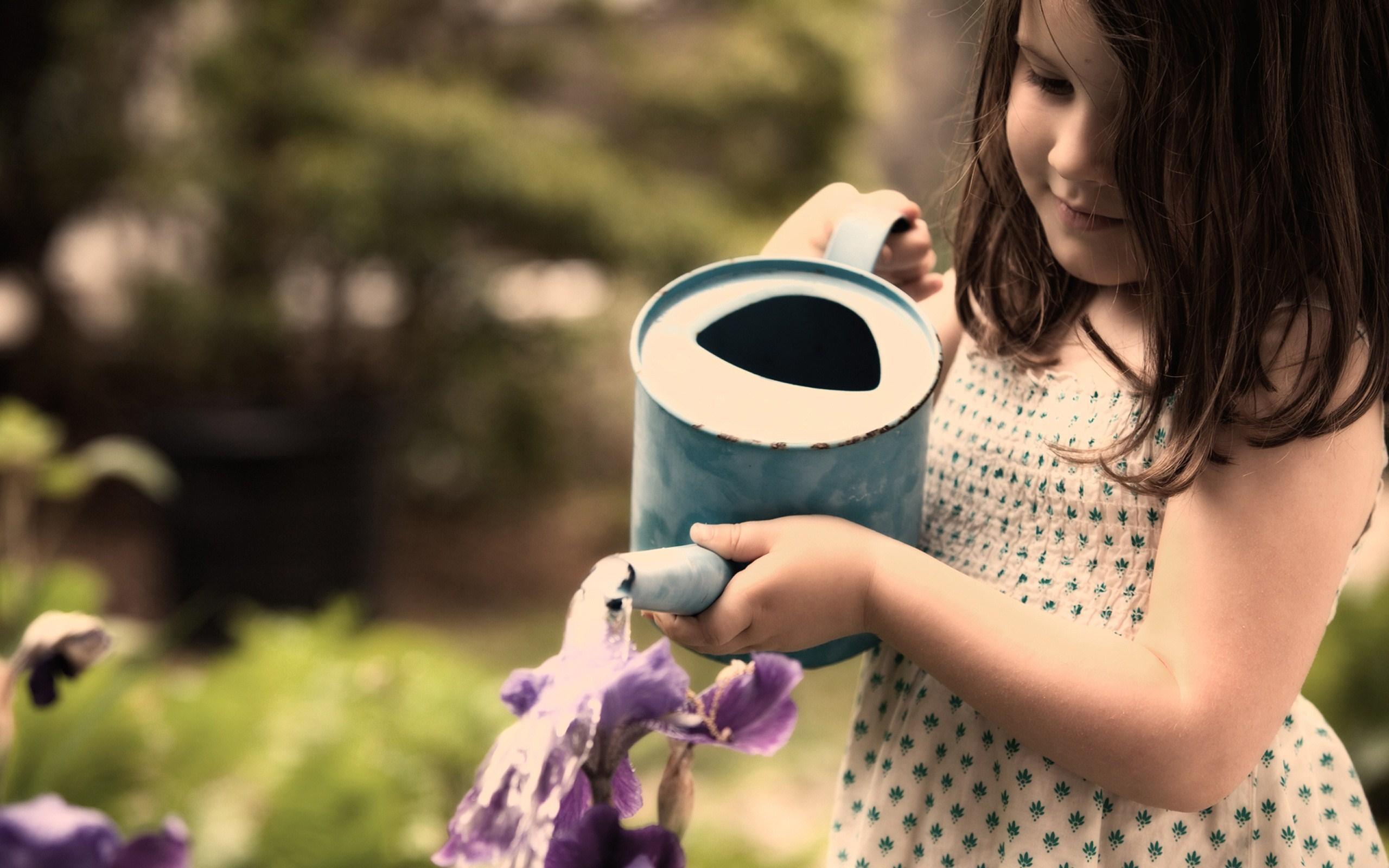Beautiful-Kid-Girl-Watering-Flowers-Wallpaper-2975