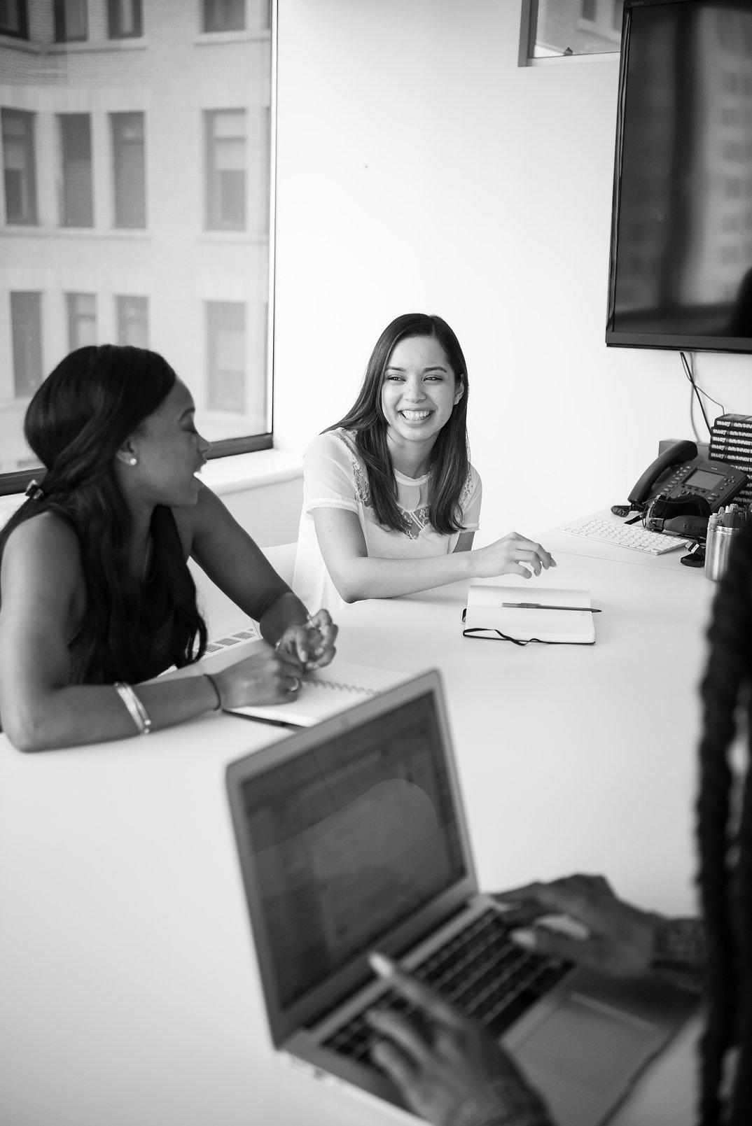 two-women-behind-table-1181634.jpg